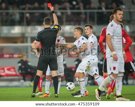 VIENNA, AUSTRIA - MARCH 26, 2016: Referee Ivan Kruzliak (Slovakia) shows the red card to Ergys Kace (Albania)  in a friendly football game.