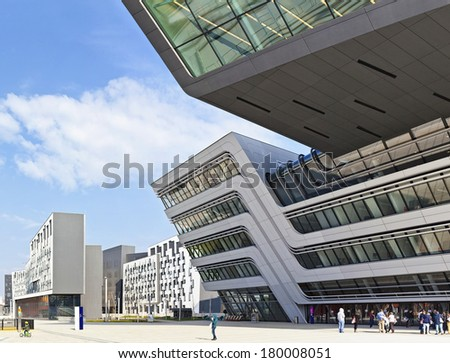 VIENNA, AUSTRIA - MARCH 2: Some People and Students in front of the new and  futuristic University of Economics and Business on March 2, 2014 in Vienna, Austria. Design by famous architect Zaha Hadid. - stock photo