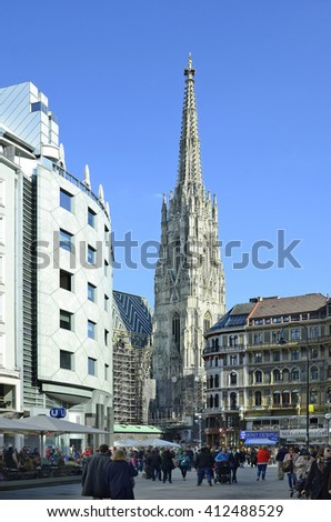 VIENNA, AUSTRIA - MARCH 27: Unidentified people on Stephansplatz with gothic cathedral and Haas-building, torust attraction and landmark, on March 27, 2016 in Vienna, Austria