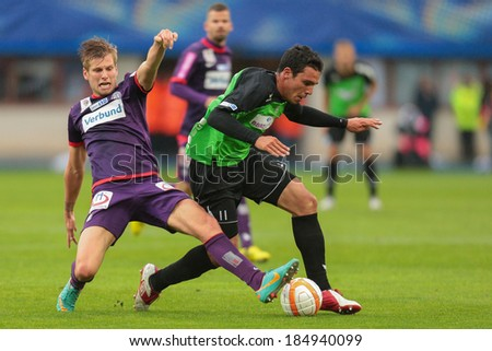 VIENNA,  AUSTRIA - MAY 30 Alexander Gruenwald (#10 Austria) and Igancio Diaz-Casanova Montenegro (#11 Pasching) fight for the ball during a Austrian cup final game on May 30, 2013 in Vienna, Austria. - stock photo