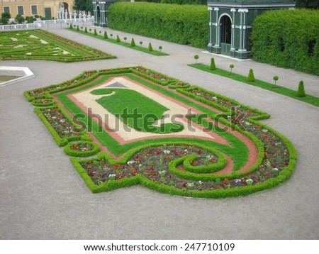 VIENNA, AUSTRIA - MAY 26, 2010: Detail from the picturesque elaborate gardens of Schoenbrunn palace in Vienna, completed in the 18th century during the reign of empress Maria Theresa. - stock photo