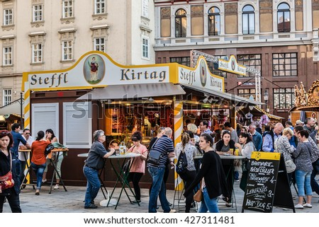 "VIENNA, AUSTRIA - MAY 7, 2016: Famous ""Steffl Kirtag"" takes place right in front of St. Stephan's Cathedrale. There are lots of stands that offer traditional food, culinary specialties, handcraft, etc"