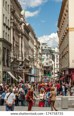 VIENNA, AUSTRIA - MAY 20: Main pedestrian street in central Vienna on May 20, 2006, in Vienna, Austria. The pedestrian dominated centre of Vienna is packed with tourists and great shopping.  - stock photo