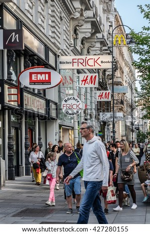 VIENNA, AUSTRIA - MAY 7, 2016: People relax and go shopping at Carinthian Street. Carinthian Street (Kaerntner Strasse) is the most famous shopping street in central Vienna.