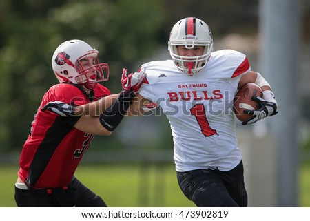 VIENNA, AUSTRIA - MAY 9, 2015:  RB Alexander Preslacher (#1 Bulls) runs with the ball in a game of the Division II of the Austrian Football League.