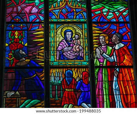 VIENNA, AUSTRIA - MAY 28, 2010: Stained glass window depicting the adoration of Mother Mary in the Votive Church in Vienna, Austria.