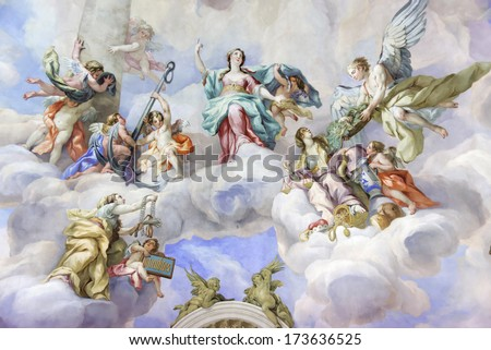 VIENNA, AUSTRIA  - NOVEMBER 23,2013: The Karlskirche (St. Charles's Church). Vibrant frescoes of saints and angels decorate the vaulted interior dome of Vienna�s Karlskirche. - stock photo