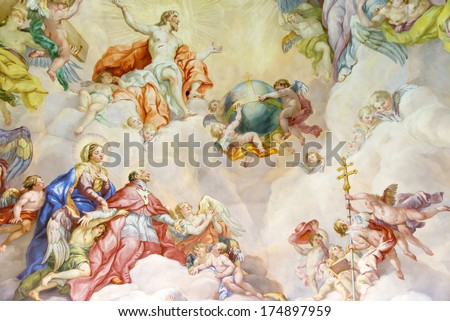VIENNA, AUSTRIA  - NOVEMBER 23,2013: The Karlskirche (St. Charles's Church). Vibrant frescoes of saints and angels decorate the vaulted interior dome of Viennas Karlskirche. - stock photo