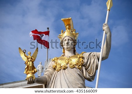VIENNA, AUSTRIA - OCTOBER 17, 2015: Detail of Athena Fountain in front of Austrian Parliament Building in Vienna. The statue was chryselephantine - made of gold and ivory. - stock photo