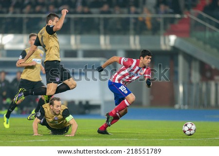 VIENNA, AUSTRIA - OCTOBER 22 Diego Costa (#19 Atletico) runs with the ball at a UEFA Champions League game on October 22, 2013 in Vienna, Austria. - stock photo