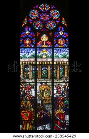 VIENNA, AUSTRIA - OCTOBER 10: Eucharistic Congress, Stained glass in Votiv Kirche (The Votive Church). It is a neo-Gothic church in Vienna, Austria on October 10, 2014 - stock photo
