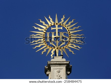 VIENNA, AUSTRIA - OCTOBER 10: IHS sign on baroque Jesuits church. The church was built between 1623 and 1627. in Vienna, Austria on October 10, 2014. - stock photo