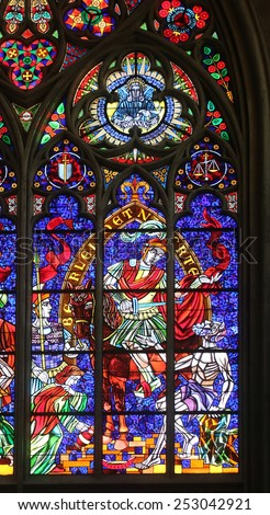 VIENNA, AUSTRIA - OCTOBER 10: St. Martin, Stained glass in Votiv Kirche (The Votive Church). It is a neo-Gothic church in Vienna, Austria on October 10, 2014 - stock photo