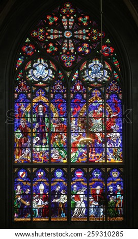 VIENNA, AUSTRIA - OCTOBER 11: St. Severin and St. Martin, Stained glass in Votiv Kirche (The Votive Church). It is a neo-Gothic church in Vienna, Austria on October 11, 2014 - stock photo