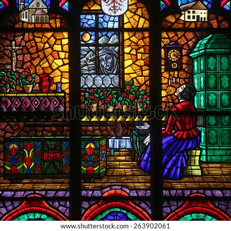 VIENNA, AUSTRIA - OCTOBER 11: The miraculous image of Mary at Absam, Stained glass in Votiv Kirche (The Votive Church). It is a neo-Gothic church in Vienna, Austria on October 11, 2014 - stock photo