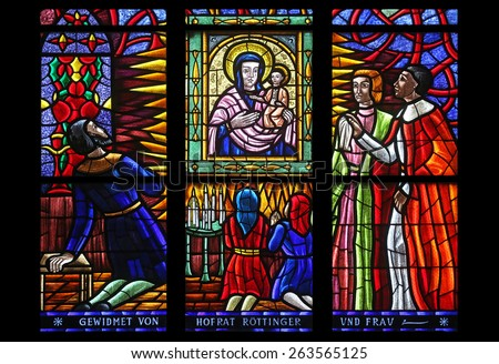 VIENNA, AUSTRIA - OCTOBER 11: The miraculous image of the Virgin and Child, Stained glass in Votiv Kirche (The Votive Church). It is a neo-Gothic church in Vienna, Austria on October 11, 2014 - stock photo