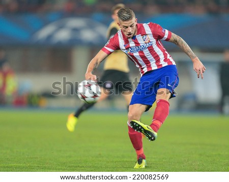 VIENNA, AUSTRIA - OCTOBER 22 Toby Alderweireld (#12 Atletico) kicks the ball at a UEFA Champions League game on October 22, 2013 in Vienna, Austria. - stock photo