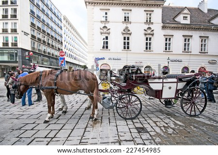VIENNA, AUSTRIA - OCTOBER 08, 2014: Traditional old-fashioned fiacres at Stephansplatz of Vienna, Austria. Stephansplatz is the most popular square in the city