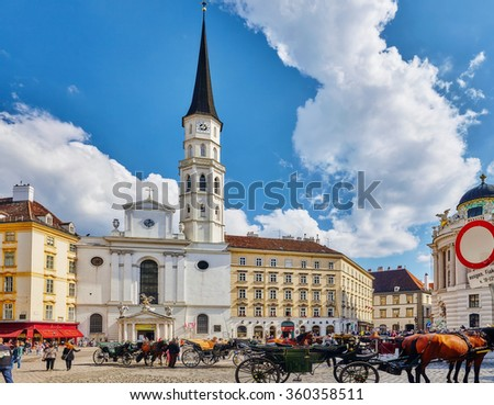 VIENNA, AUSTRIA- SEPTEMBER 10, 2015: Carriage horses walking in the streets of one of the most beautiful European cities - Vienna.Austria - stock photo