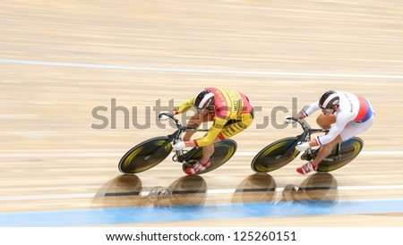 VIENNA,  AUSTRIA - SEPTEMBER 27  David Sojka and Lubomir Vojta (Czech Republic) compete in the men's team sprint event of an indoor cycling meeting on September 27, 2012 in Vienna, Austria. - stock photo