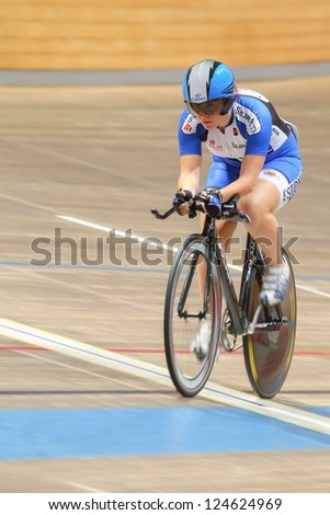 VIENNA,  AUSTRIA - SEPTEMBER 27  Evelin Idarand (Estonia) competes in the women's individual pursuit event of an indoor cycling meeting on September 27, 2012 in Vienna, Austria. - stock photo
