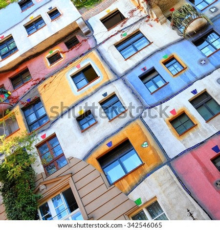 VIENNA, AUSTRIA - SEPTEMBER 6, 2011: Hundertwasser Haus in Vienna. The iconic building by famous architect is one of reasons to visit Vienna. - stock photo