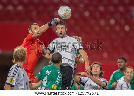 VIENNA,  AUSTRIA - SEPTEMBER 20 Keeper Daniel Oerlund (#1 Trondheim) knocks away the ball during the Europa League soccer game on September 20, 2012 in Vienna, Austria.