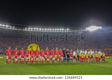 VIENNA,  AUSTRIA - SEPTEMBER 11 The Austrian and the German team during the national anthem before the WC qualifier soccer game on September 11, 2012 in Vienna, Austria. - stock photo