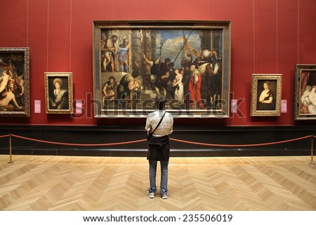 VIENNA, AUSTRIA - SEPTEMBER 8, 2011: Tourist admires art in Museum of Art History in Vienna. With 559k visitors in 2010, the museum is among 100 most visited museums worldwide. Art of Rubens. - stock photo