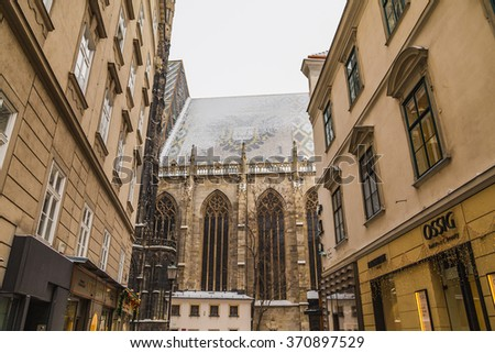 VIENNA, AUSTRIA - 5TH JANUARY 2016: Part of St. Stephen's Cathedral (Stephansdom) in Vienna from Churhausgasse during the winter. Snow can be seen on the building. - stock photo
