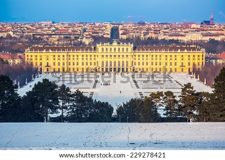 VIENNA - DECEMBER 13 2012: Schonbrunn Palace, Vienna, Austria illuminated by sunset on December 13, 2012. The 1441-room palace is the major tourist attraction in Austria since 1960s. - stock photo