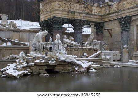 Vienna - fountain in schonbrunn palace - old rome ruins in winter