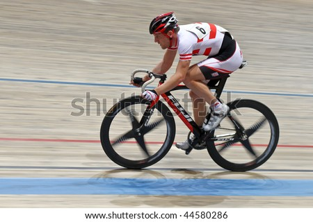 VIENNA - JANUARY 11: Indoor track cycling meeting - Andreas Mueller (Austria) places ninth in men's point race final on January 11, 2010 in Vienna, Austria. - stock photo