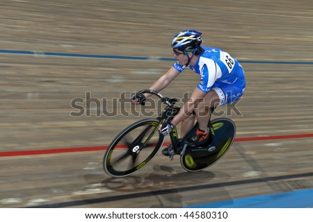 VIENNA - JANUARY 12: Indoor track cycling meeting - Francesco Ceci (Italy) wins the men's keirin race on January 12, 2010 in Vienna, Austria. - stock photo