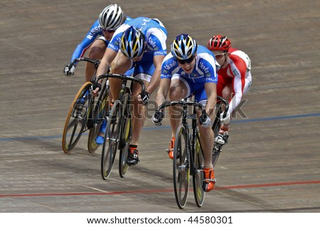 VIENNA - JANUARY 12:Indoor track cycling meeting - Italian Francesco Ceci (2nd R) wins the men's keirin final on January 12, 2010 in Vienna, Austria. - stock photo