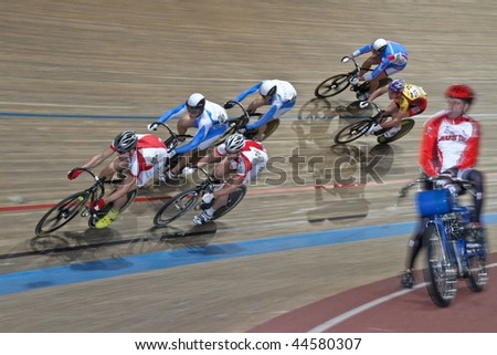 VIENNA - JANUARY 12:Indoor track cycling meeting - Polish Lukasz Kwaitkowski (L) places seventh in the men's keirin race on January 12, 2010 in Vienna, Austria. - stock photo