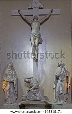 VIENNA - JULY 3:  Jesus on the cross with hl. Mary and st. John in Michaelerkirche or st. Michael  church on July 3, 2013 Vienna. - stock photo