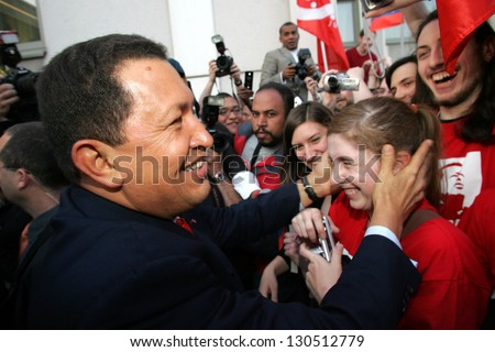 VIENNA - MAY 11: Venezuelan President Hugo Chavez greets a crowd in Vienna, Austria, on Thursday, May 11, 2006. - stock photo