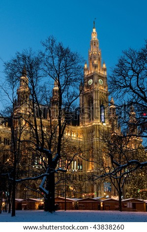 Vienna's Town Hall (Rathaus) lit by lights during Christmas time, Austria - stock photo