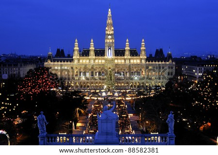 Vienna's Town Hall (Rathaus) with Christmas Market in front - stock photo