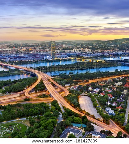 Vienna with the Danube River, the highway (no. A22) junction and one of the most interesting extensive public recreation area called Danube Island (german: Donauinsel). - stock photo