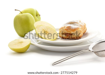 Viennese apple strudel  on white background with apple slices - stock photo
