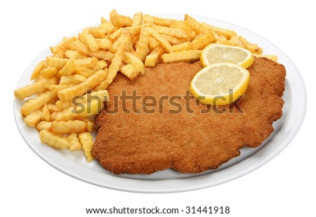 Viennese Schnitzel with fries - stock photo