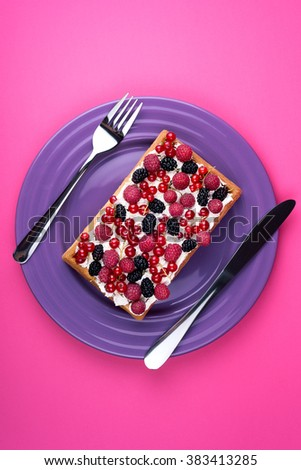 Viennese waffles cake on plate with knife and fork on pink background. Top view  - stock photo