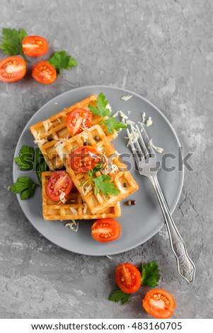 Viennese waffles on a plate with tomatoes and cheese
