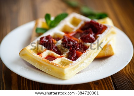 Viennese waffles with powdered sugar  - stock photo