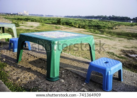 Vientiane, Lao PDR, May 2017, Small Low Plastic Table And Stool On The