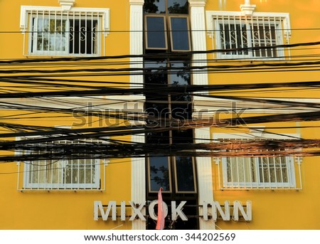 VIENTIANE,LAOS-OCTOBER 13, 2015: Wirings largely hide colonial facades of the capital on October 13, Vientiane, Laos.