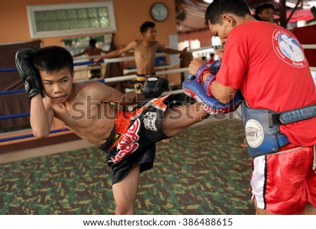 VIENTIANNE - LAOS - JANUARY 25, 2014: Unidentified traditional Muay Lao boxer at a traditional rural tournament on January 25, 2014 in a village near Vientianne, Laos - stock photo