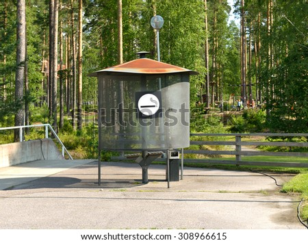 VIERUMAKI, FINLAND - JULY 18, 2015: Flowpark is adventure theme park. This is a place to smoke outdoors. In many parks there are restrictions against smoking - stock photo